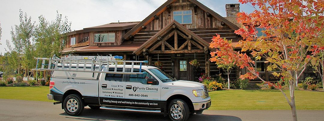 Purity Cleaning gutters on log cabin home in Bitterroot Valley