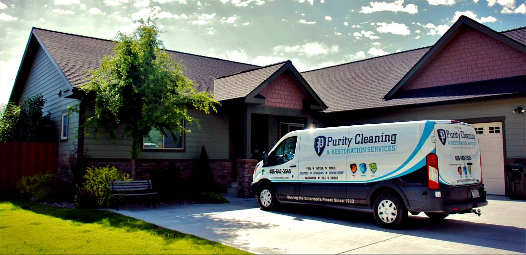 Purity Carpet cleaning van sitting in the driveway of a home