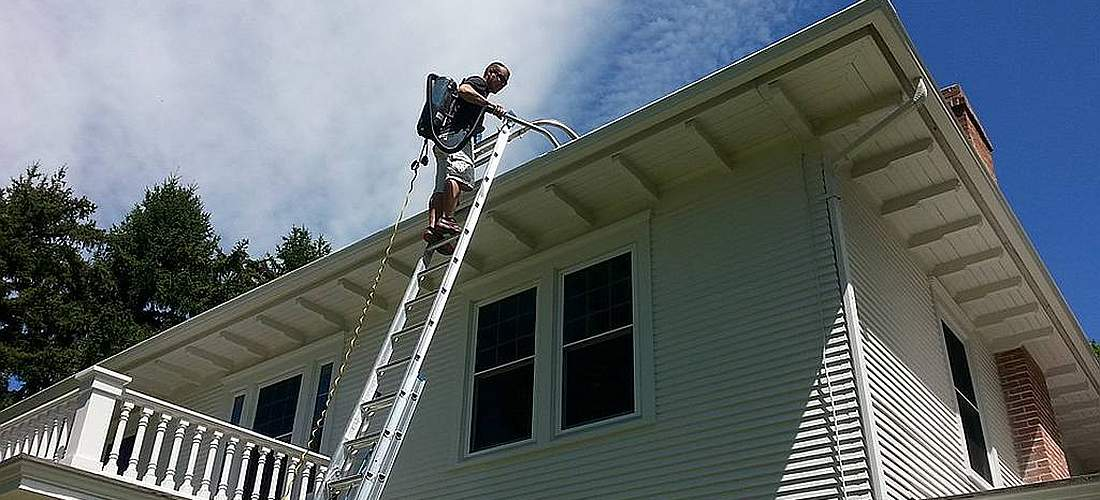 David On A Ladder Cleaning Gutters Two Story House